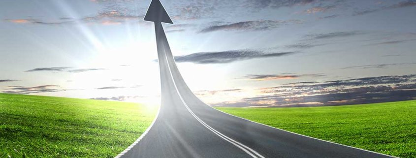 road leading up to the sky turning into an arrow