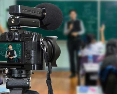 video camera recording a teacher in a classroom