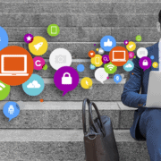 business person working on a laptop with social media icons