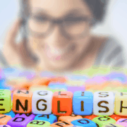 english in colored letterblocks with a virtual assistant in the background