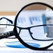 myoutdesk branded magnifying glass reveal glasses and a chart