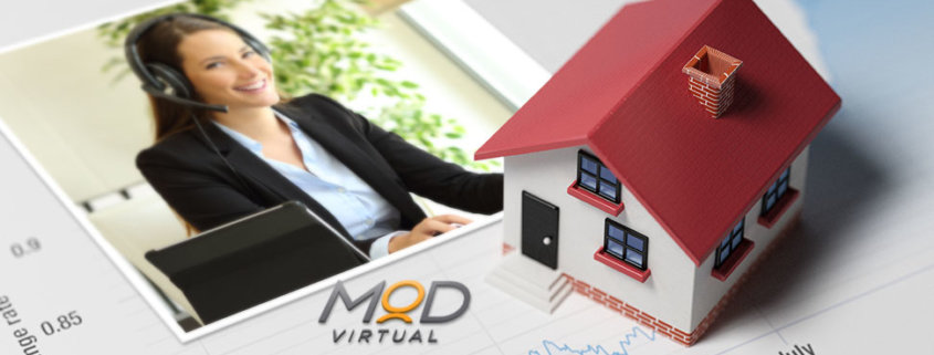 picture of a myoutdesk real estate virtual assistant on a desk next to a tiny house