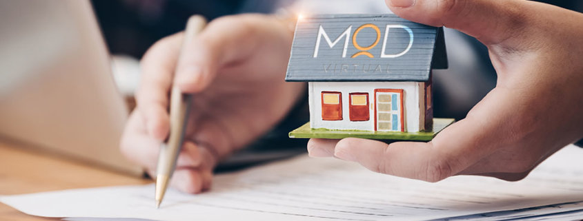 myoutdesk real estate virtual assistant holding a tiny house doing paperwork