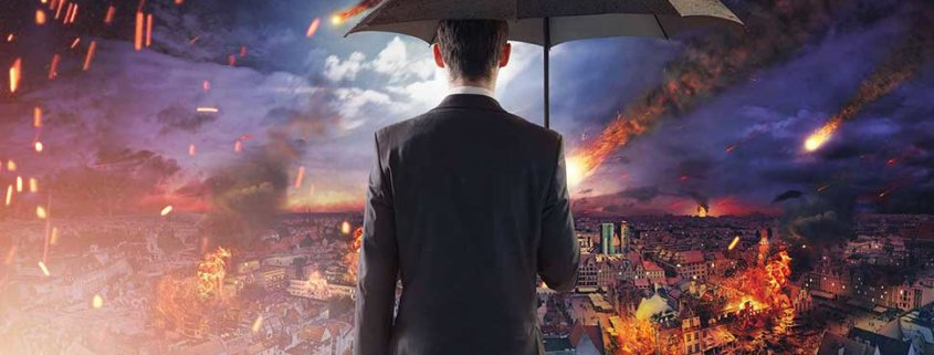 business owner with an umbrella looking out at a burning real estate market