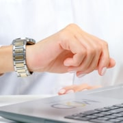 myoutdesk virtual assistant checking the time on her watch