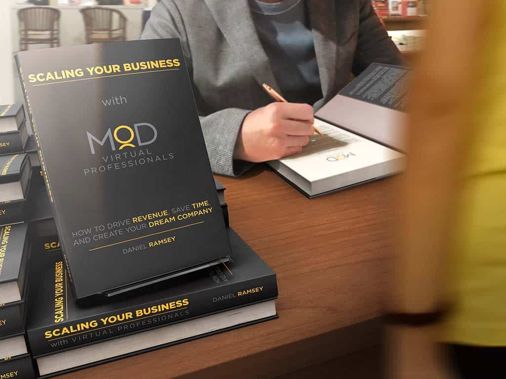 author signing book autographs book covering saying scaling your business with myoutdesk virtual professionals