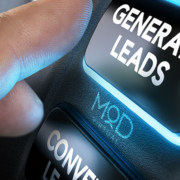 finger hitting a button that says generate leads