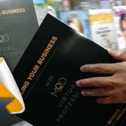 scaling your business book being opened by a reader but it now at amazon