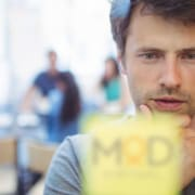business owner looking post-it notes contemplating next move