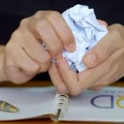 myoutdesk virtual assistant hands crumpling a paper into a ball