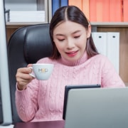 a happy virtual assistant working remotely