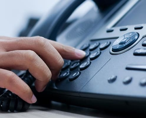 myoutdesk virtual receptionist dialing on a phone