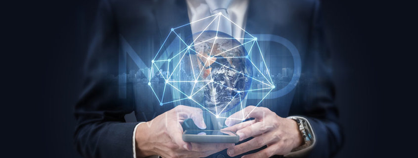 businessman holding a smartphone with a virtual globe above it and myoutdesk logo