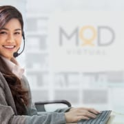 a happy myoutdesk real estate virtual assistant smiling