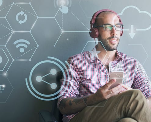 entrepreneur surrounded by virtual graphics listening to a podcast