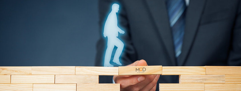 a virtual figure walking across a bridge of wooden blocks with the gap filled with myoutdesk