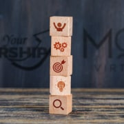 upsize your leadership and myoutdesk with 4 wooden blocks with a people, gears, target, lightbulb and search