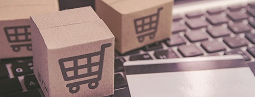 small shipping boxes with a shopping cart logo ecommerce virtual assistants