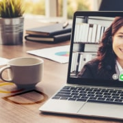 a happy virtual assistant on a video call on a latop