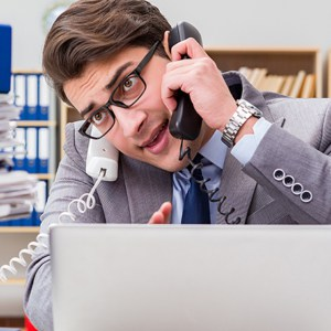 business man stressed on the phone trying to function