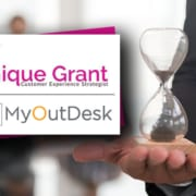 yanique grant customer experience strategist with myout desk a hand holding an hour glass