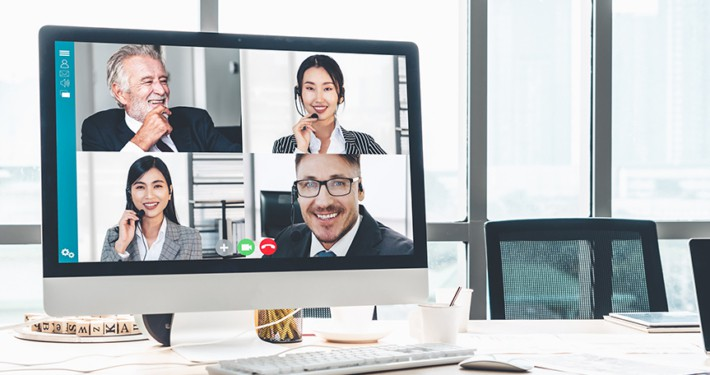 a computer screen showing a four person video conference