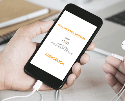 scaling your business with virtual professionals audiobook on phone screen being held