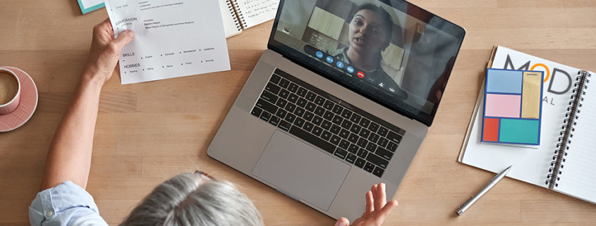 a business owner working on her laptop with her myoutdesk virtual assistant on video call