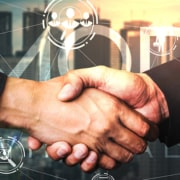 two hands shaking showing a hybrid business model