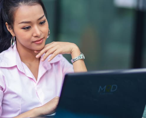 a myoutdesk virtual assistant working remotely at her laptop