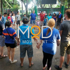 MOD Movement logo with a circle of people holding hands