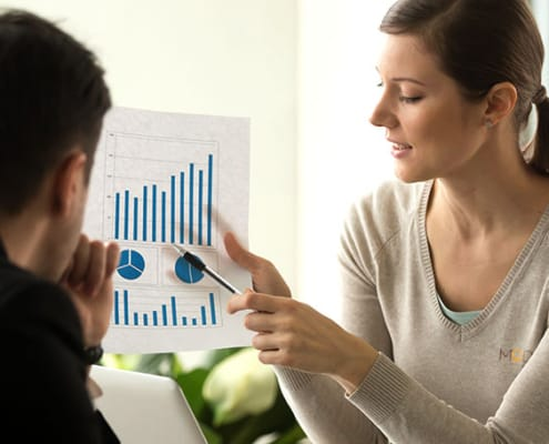 virtual assistant woman holding up a chart for tax season