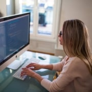 woman working at a computer using slack workspaces with a virtual assistant