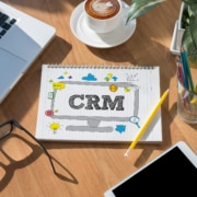 """notebook showing """"crm"""" on desk enefits of zoho crm with virtual assistants"""