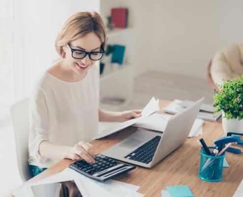 business owner working at desk comparing fiverr to upwork comparing freelance platforms