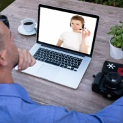 man talking with a virtual receptionist on his laptop hire and train a virtual receptionist