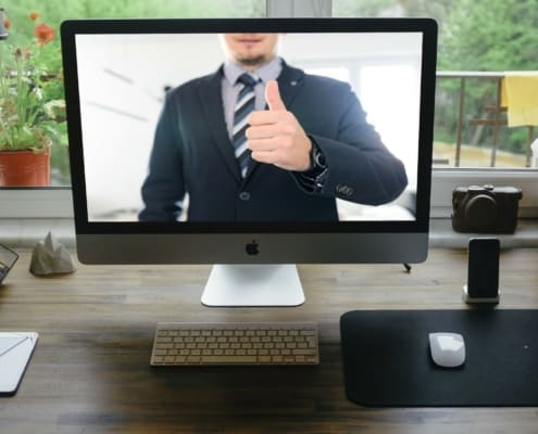 virtual man on screen giving thumbs up onboarding a virtual assistant