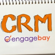 documents and a notepbook with written CRM and engagebay logo