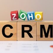 wooden cubes with CRM print and zoho logo