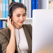 virtual assistant in front of computer working