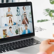 Laptop showing a video group call of virtual assistants