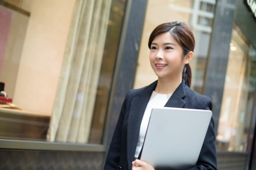 Business woman holding her personal laptop