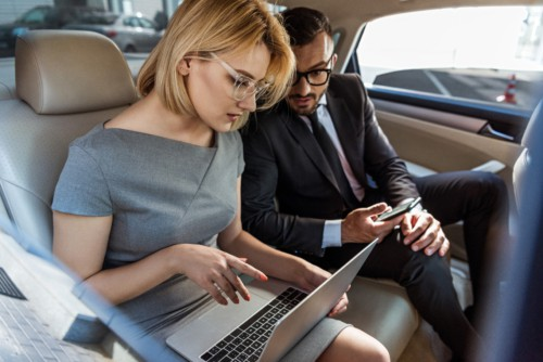 businessman assistant working in car with laptop