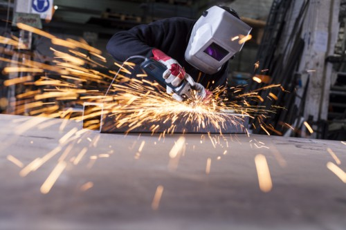 metalworker grinding with sparks
